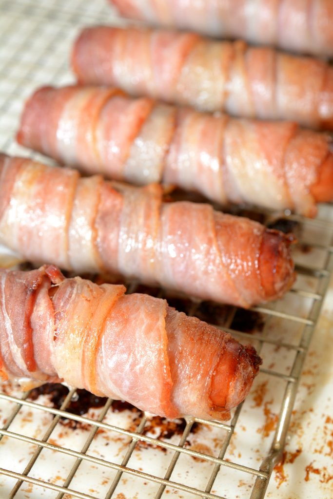 Looking for a keto dinner recipe? You will love this Keto Bacon Wrapped Brats with beer cheese sauce. Never has anything that is considered diet food tasted so good. Whether you are on a low-carb diet, keto diet or just looking for a delicious hearty meal - these bacon wrapped brats with beer cheese sauce are for you.