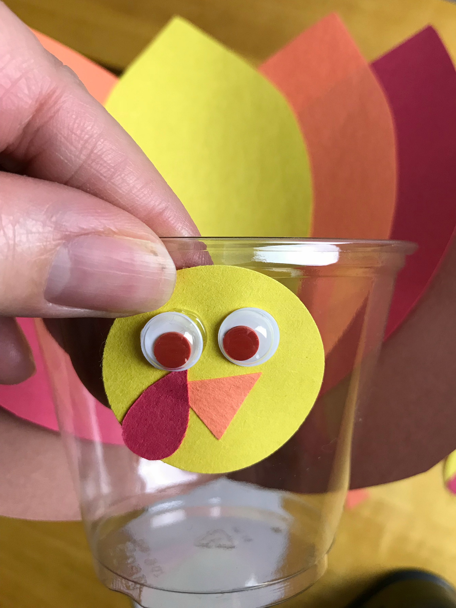 Looking for a fun Thanksgiving Day craft? Have kids make this turkey cup crayon holder and use the crayons on the printable Thanksgiving Placemat.