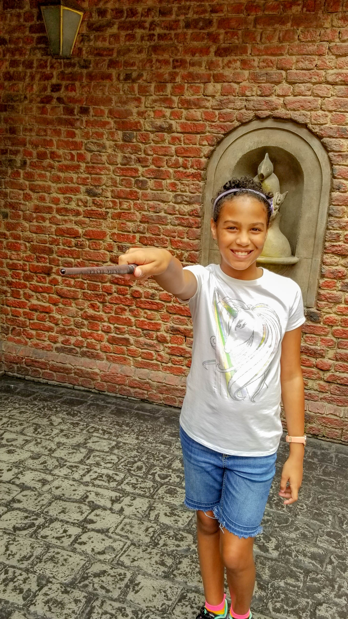T practicing with wand in Wizarding World of  Harry Potter™