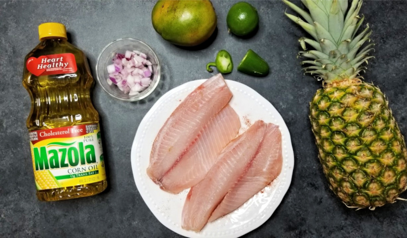 Lighten up your summer with delicious grilled tilapia topped with a fresh pineapple mango salsa. You can't beat a fresh juicy pineapple, and the mango puts this grilled fish and tropical salsa recipe over the top. Diced jalapeno adds just the right amount of kick to this light, refreshing summertime meal. It's a simple grilled fish recipe that takes little time to prepare.