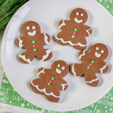 I have a fun twist on a classic Christmas cookie for you! Do you love the idea of gingerbread men, but you don't actually like the taste of gingerbread men? Don't worry, I have the perfect solution. Try this Chocolate Sugar Cookie recipe.