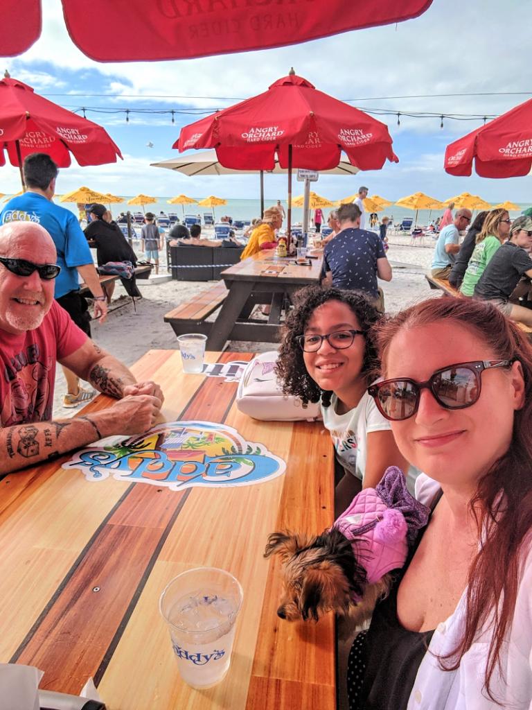 Florida Prepaid Open Enrollment 2020 Promo Code - Image of Florida family having lunch on the beach in Treasure Island, Florida.