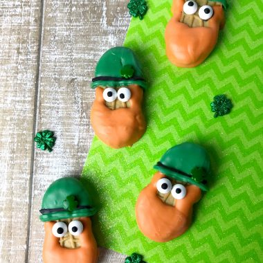 If you want the cutest St Patrick's Day cookies, you want to make these adorableLeprechaun Cookies made with Nutter Butters. These cookies look so cute and they are super easy to make. Perfect for a St. Patrick's Day party for kids and adults alike.