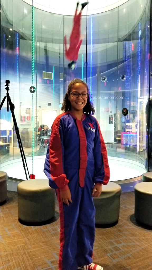 girl doing indoor skydiving
