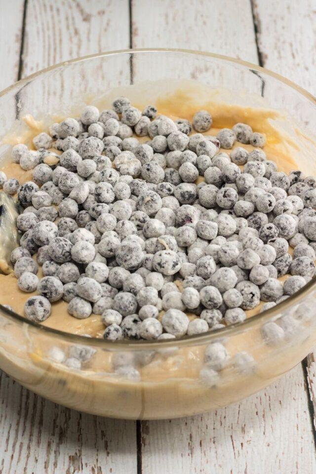 flour covered blueberries in batter