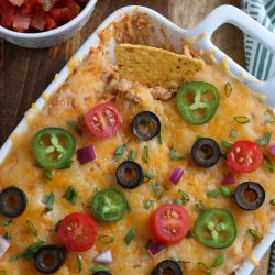 This Easy Bean Dip is one of my favorite game day recipes to make. Perfect for parties and special occasions, this bean dip is tasty and inexpensive and is always a hit. Serve it for a simple appetizer or make it when having festive Mexican night.