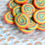 Rainbow Swirl Cookies, also known as pinwheel cookies, are fun to make and even more fun to eat. Take your sugar cookies to a whole new level with these rainbow spiral cookies. These cookies are a beautiful with a crunchy chewy texture. One bite and you are going to have a new favorite cookie.