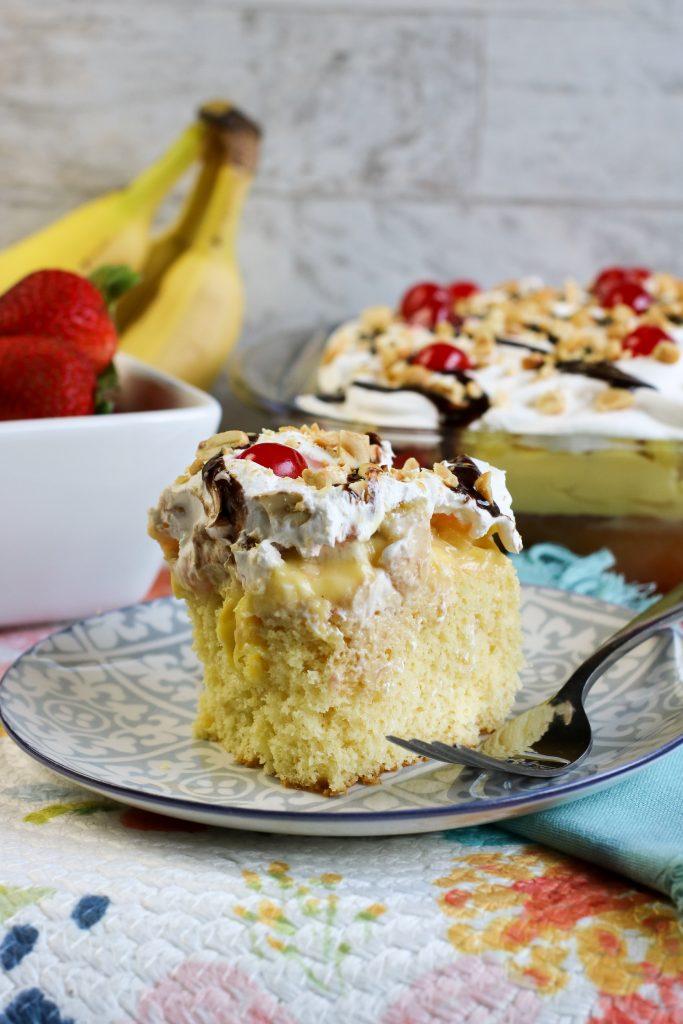 piece of banana split poke cake