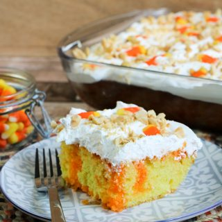 Do you like candy corn? I'm totally on Team Candy Corn! Even if you just like it a little, I think you are going to absolutely love this easy-to-make Candy Corn Poke Cake. I happen to be a huge fan of both candy corn and poke cakes so this Halloween dessert is totally for me. A delicious moist cake that not only is delicious involves candy corn. This festive poke cake recipe is perfect for the Halloween and Fall season.