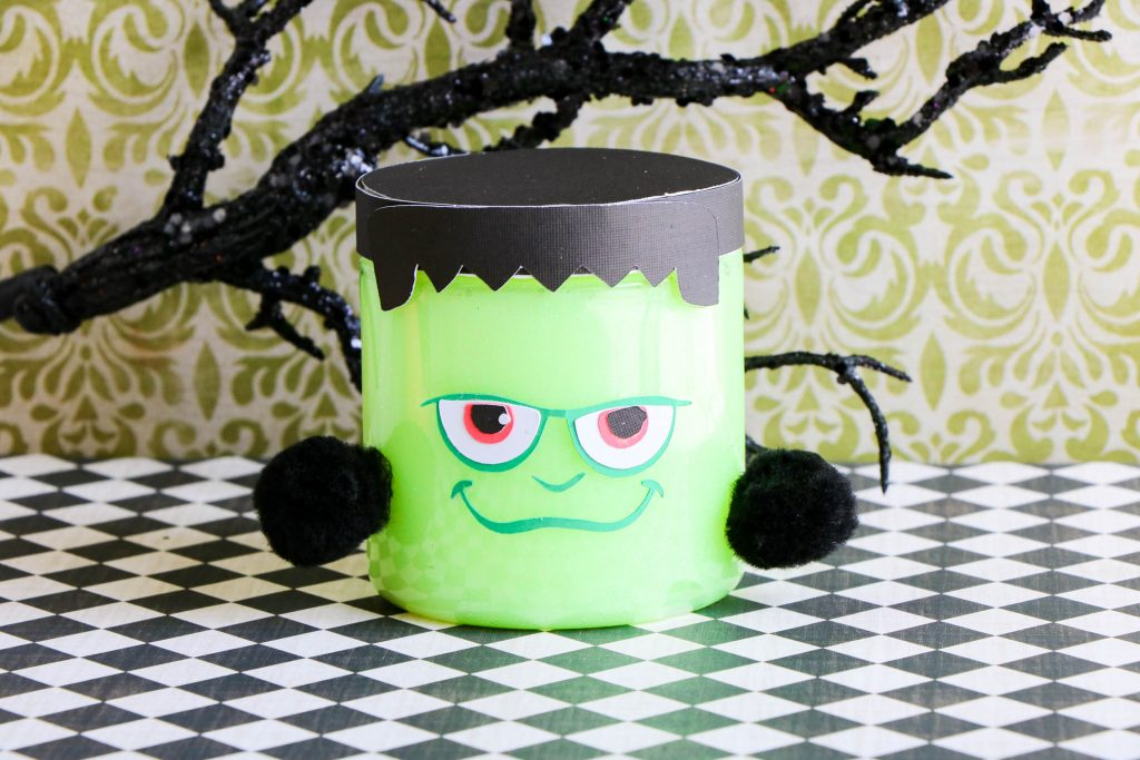Making Frankenstein Glow in the Dark Slime is a fun Halloween activity to do with kids.