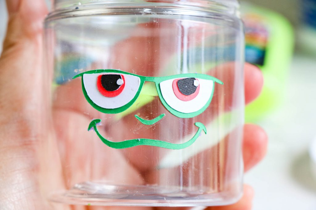 place the face on the jar
