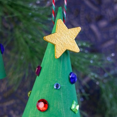 This Easy Paper Christmas Tree Ornament is the perfect thing to make with friends and family and you're sure to have so much fun making them.