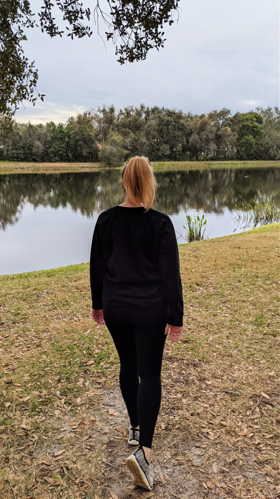 woman walking outside for fitness