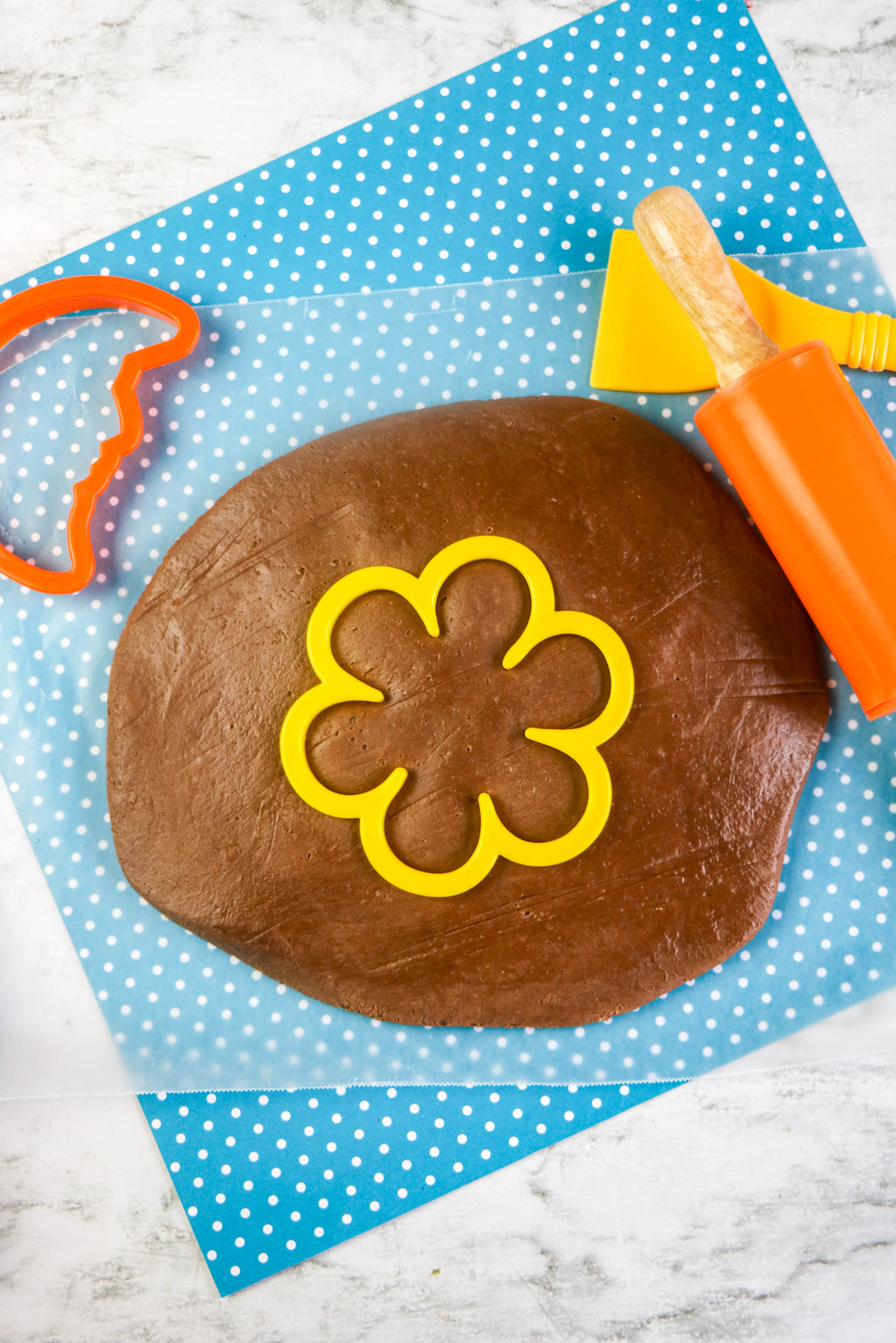 This chocolate homemade playdough recipe is made with just two ingredients and is a terrific activity for younger kids. Edible playdough is a yummy fun with food activity.