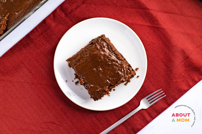 This cherry chocolate cake is so simple to make but is decadent enough for special occasions. A moist chocolate cake mix and a can of cherry pie filling come together for a fudgy and delicious dessert. The fudge frosting puts this sheet cake over the top!
