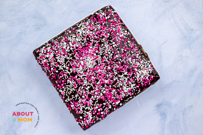 spread Valentine's Day sprinkle mix over brownies