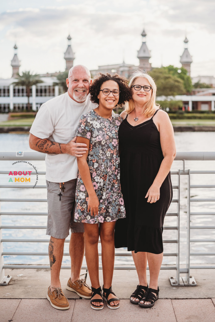 family photo with University of Tampa minarets in the background