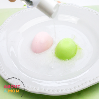 This fun Easter science experiment teaches chemical reactions! Frozen baking soda egg molds that fizz when vinegar touches them - SO cool!