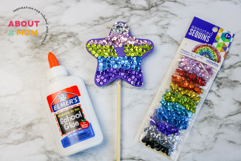 decorate the mermaid wand with sequins