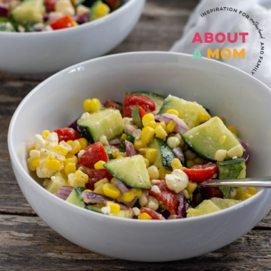 This Fresh Corn Salad recipe is full of flavor with fresh-from-the-cob corn, tomatoes, cucumber, red onion, feta cheese, a simple homemade vinaigrette and more.  Serve this Fresh Corn Salad as a summer lunch or a delicious side dish alongside your favorite BBQ!