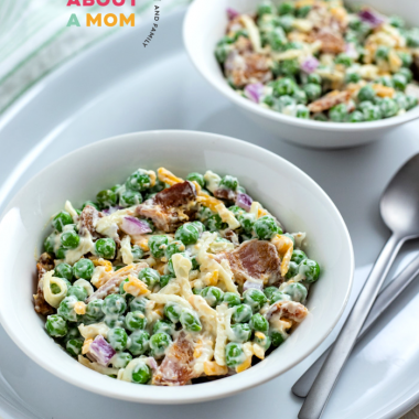 Peas, bacon, red onion, cheese and a creamy sauce come together to make a delicious classic pea salad that everyone will enjoy.