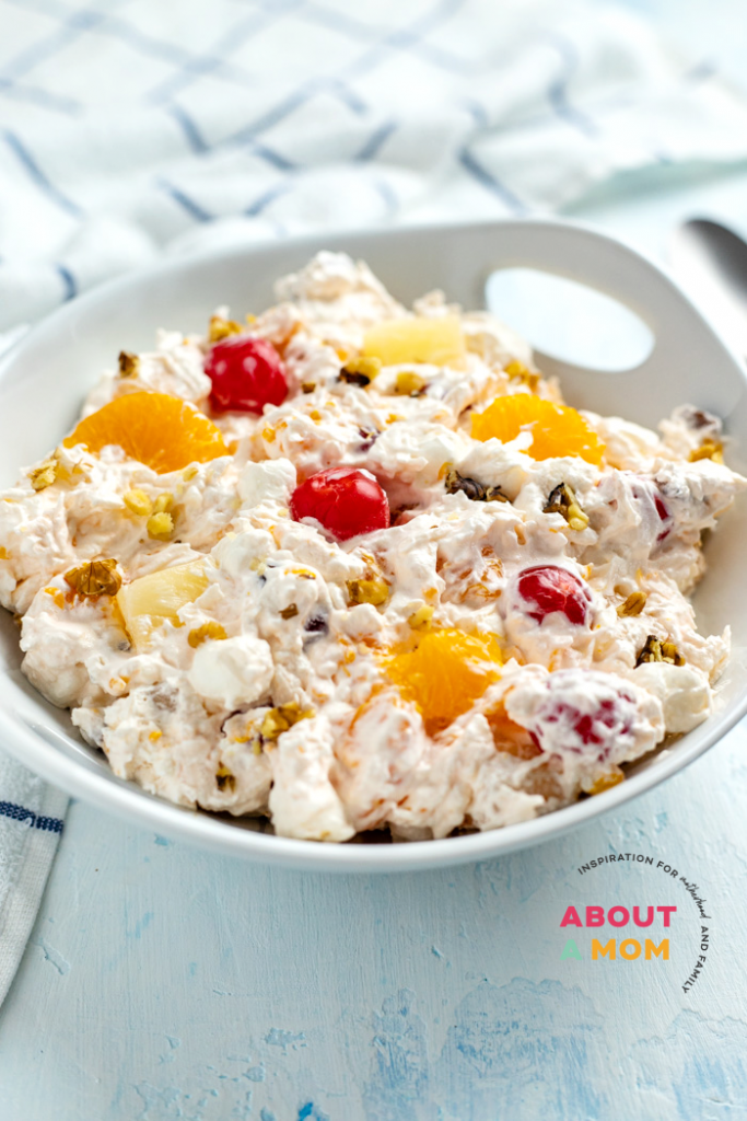 Ambrosia Salad is a classic fruit salad that's been around since the days of potlucks. This easy fruit salad is perfection with a sweet and fluffy whipped cream dressing, soft mini marshmallows and colorful fruit.