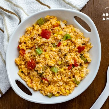 This is the best easy cheesy Mexican rice recipe. It is a restaurant-style Spanish rice recipe that comes together in no time. Serve this flavorful Mexican side dish with your favorite enchiladas or chimichangas. It is the perfect side for Taco Tuesday!