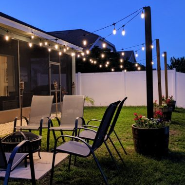 Have you wondered to to hang outdoor string lights? Make whiskey barrel planters with built-In posts for string lights. Add ambiance to your backyard with this step-by-step tutorial for a DIY planter with pole for string lights.