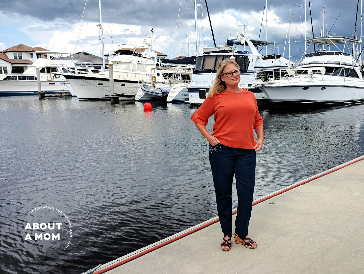 woman wearing straight-let Blair DenimEase jeans at a marina
