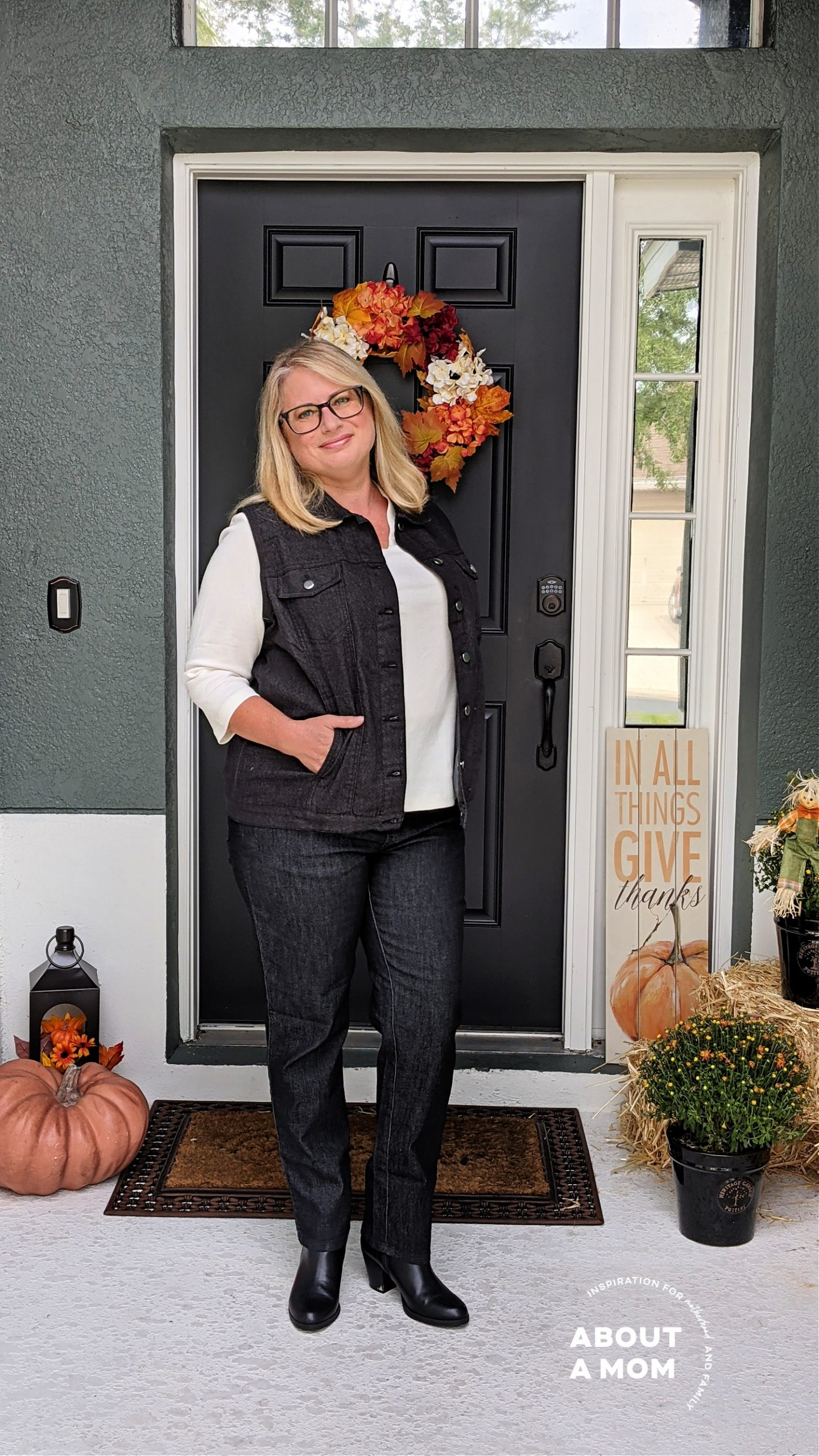 woman wearing black jeans and a black denim jacket from Blair