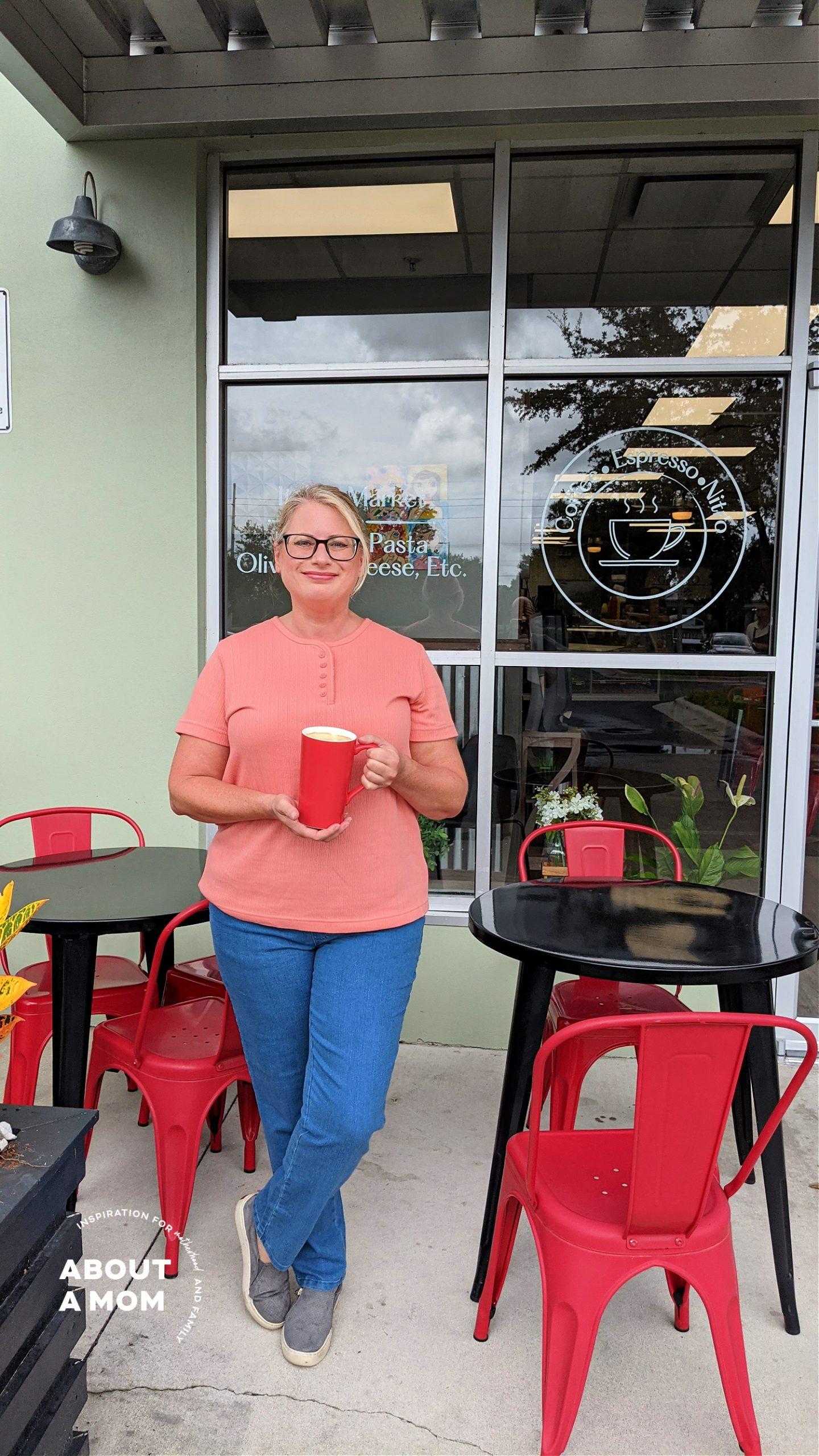 woman in jeans drinking a fall pumpkin spice latte